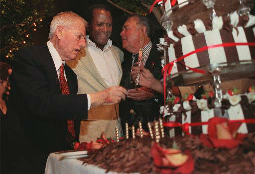 Director Stanley Kramer, left, reaches for a knife to cut a cake prepared in his honor with actors Sidney Poitier and Jonathan Winters during a tribute, Tuesday Sept. 23, 1997 in Los Angeles.  Winters starred in Kramer&#39;s film &#34;Its a Mad, Mad, Mad, Mad World.&#34;  Kramer, who has produced or produced and directed approximately 35 films including &#34;Guess Who&#39;s Coming to Dinner&#34; with Sidney Poitier, was honored during the &#34;Stanley Kramer Celebration of Life and Work&#34; Tuesday.  <span class=meta>(AP Photo&#47; E.J. FLYNN)</span>
