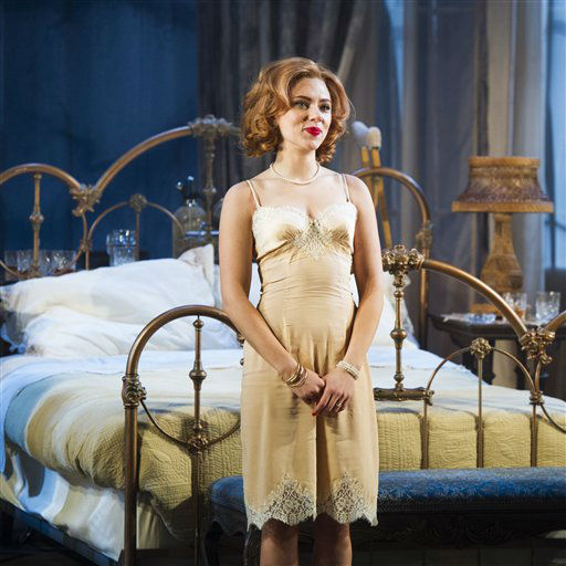 "<div class=""meta image-caption""><div class=""origin-logo origin-image ""><span></span></div><span class=""caption-text"">Scarlett Johansson appears at the curtain call for the opening night performance of the Broadway play ""Cat on a Hot Tin Roof"" on Thursday, Jan. 17, 2013 in New York.  (AP Photo/Charles Sykes)</span></div>"