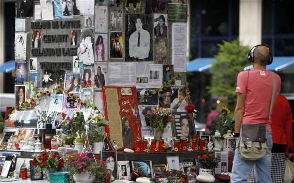 A man looks at a memorial for the late US pop star Michael Jackson in Munich, southern Germany, on Thursday, June 24, 2010. The death of Jackson, one year later, continues to captivate the world. (AP Photo/Matthias Schrader)