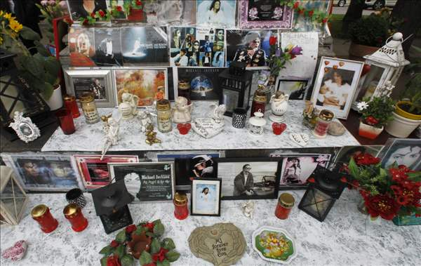 A memorial for the late US pop star Michael Jackson in Munich, southern Germany, on Thursday, June 24, 2010. The death of Jackson, one year later, continues to captivate the world. (AP Photo/Matthias Schrader)