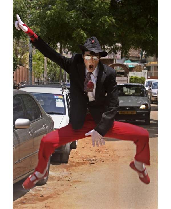 Munna Kesari, a Michael Jackson impersonator, dances in front of the media on the King of Pop's first death anniversary, in Hyderabad, India, Friday, June 25, 2010. (AP Photo/Mahesh Kumar A)