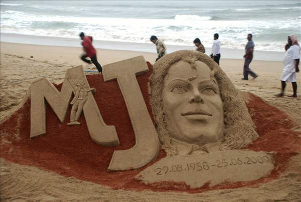 "<div class=""meta ""><span class=""caption-text "">People walk past a sand sculpture of US performer Michael Jackson created to mark the first anniversary of his death, at the Bay of Bengal coast, in Puri, Orissa state, India, Thursday, June 24, 2010. (AP Photo)</span></div>"