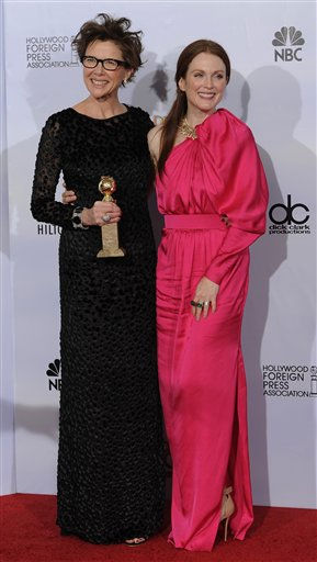 "<div class=""meta ""><span class=""caption-text "">Annette Bening holds up the award she won for Best Performance by an Actress in a Motion Picture - Comedy or Musical for her role in ""The Kids Are All Right,"" with co-star Julianne Moore, right, at the Golden Globe Awards Sunday, Jan. 16, 2011, in Beverly Hills, Calif.  The movie has been nominated for a best picture Academy Award.  (AP Photo/ Mark J. Terrill)</span></div>"