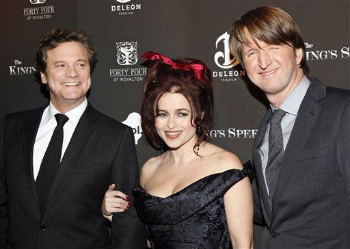 From left to right, actors Colin Firth and Helena Bonham Carter, and film director, Tom Hooper, arrive to the premiere of &#34;The Kings Speech&#34; in New York, Monday, Nov. 8, 2010. The film is based on the true story of King George VI and his remarkable friendship with maverick Australian speech therapist Lionel Logue. The movie has been nominated for a best picture Academy Award. <span class=meta>(AP Photo&#47; Stuart Ramson)</span>