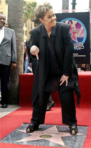 "<div class=""meta ""><span class=""caption-text "">In this Friday, April 18, 2003, photo, legendary singer Etta James points to her star after an unveiling ceremony on the Walk of Fame, in the Hollywood section of Los Angeles.  (AP Photo/ NICK UT)</span></div>"