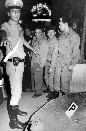 "<div class=""meta ""><span class=""caption-text "">US actor Peter Falk, center, on the spot of the bomb attack in the central Via Veneto in Rome, Monday, Sept. 12 1985. Foreground, a carabiniere (paramilitary policeman), and bottom right an unexploded handgrenade.  (AP Photo/ FELICE QUINTO)</span></div>"