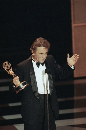 In a gesture reminiscent of his best-known character, Peter Falk accepts the Emmy Award for Best Actor in a Drama for his title role in the &#34;Columbo&#34; series at the 42nd annual Emmy Awards on Sunday, Sept. 16, 1990 in Pasadena.  <span class=meta>(AP Photo&#47; Nick Ut)</span>