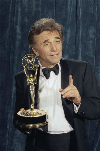 Peter Falk displays his Emmy Awards after being named lead actor for a drama series for his role in &#34;Colombo&#34; on Sunday, Sept. 17, 1990 during the 42nd Annual Prime Time Emmy Awards in Pasadena, Calif.  <span class=meta>(AP Photo&#47; Douglas C. Pizac)</span>