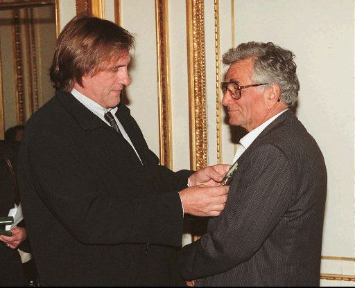 French film star Gerard Depardieu, left, pins the medal of Chevalier of Arts and Letters on the jacket of American actor Peter Falk, best-known for the detective he played for years in television&#39;s &#34;Colombo&#34;, during a Culture Ministry ceremony at a Parisian hotel Thursday Feb.29, 1996. <span class=meta>(AP Photo)</span>