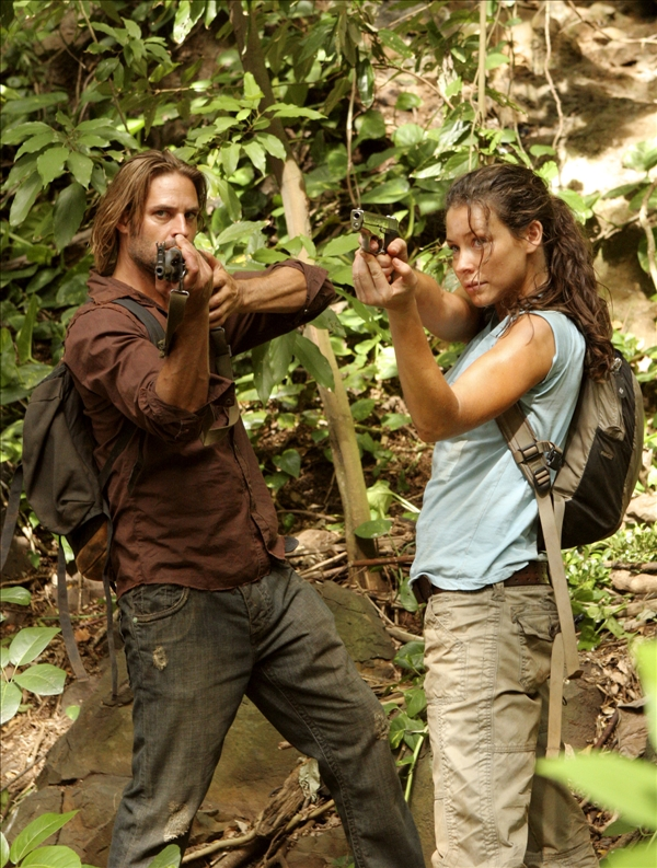 This 2006 publicity photo, released by ABC, shows actors Josh Holloway and Evangeline Lily ready to fire in the season finale of the ABC series &#34;Lost.&#34;   <span class=meta>(AP&#47;ABC, Mario Perez)</span>