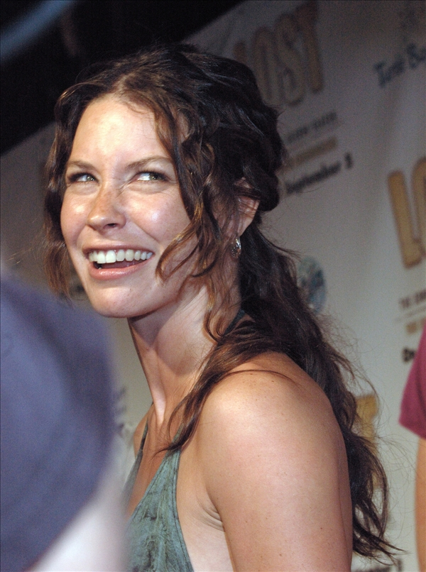 Actress Evangeline Lilly of ABC&#39;s TV show &#34;Lost&#34; makes a face at Josh Holloway, not shown, on the red carpet  before the season two DVD release party at the Turtle Bay Resort in Kahuku, Hawaii, Tuesday,  Aug. 15, 2006.   <span class=meta>(AP&#47;Lucy Pemoni)</span>