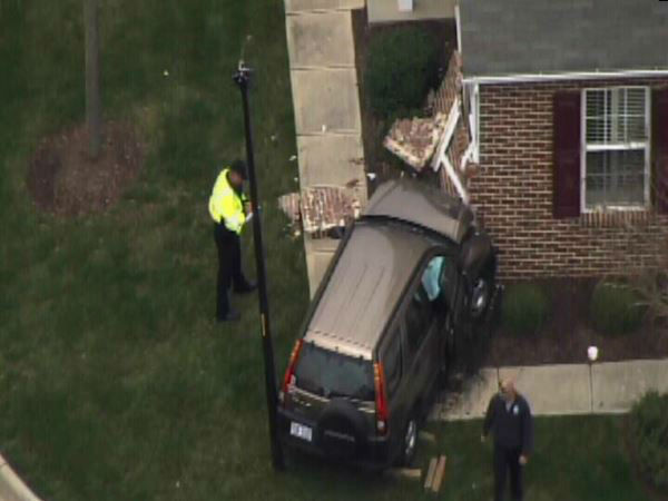 A small SUV ran into the side of a townhome building in the 500 block of Ringleaf Ct. in Cary Tuesday. <span class=meta>(WTVD Photo)</span>