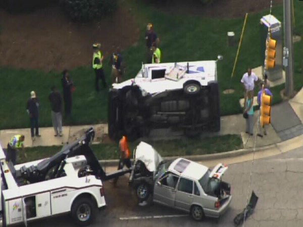 A car and a USPS delivery vehicle collided Monday morning at Valley Stream and Buffaloe Rd in Raleigh. <span class=meta>(WTVD Photo)</span>