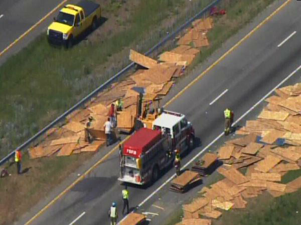 An accident involving a truck carrying sheets of wood and a camper on I-95 North Monday afternoon shut down the highway near Exit 87, Keen Road, near Benson. <span class=meta>(WTVD Photo)</span>