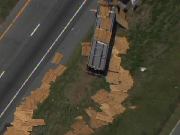 "<div class=""meta ""><span class=""caption-text "">An accident involving a truck carrying sheets of wood and a camper on I-95 North Monday afternoon shut down the highway near Exit 87, Keen Road, near Benson. (WTVD Photo)</span></div>"