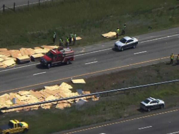 "<div class=""meta image-caption""><div class=""origin-logo origin-image ""><span></span></div><span class=""caption-text"">An accident involving a truck carrying sheets of wood and a camper on I-95 North Monday afternoon shut down the highway near Exit 87, Keen Road, near Benson. (WTVD Photo)</span></div>"
