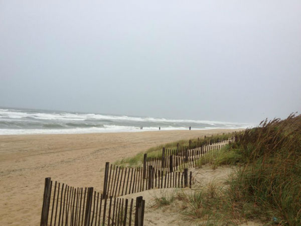 "<div class=""meta ""><span class=""caption-text "">Large swells from Sandy Saturday morning at Wrightsville Beach. Est. 8-12ft breakers in sets.</span></div>"