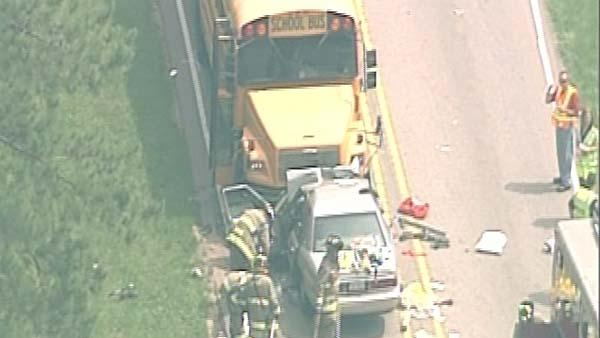 Car collides head-on with school bus