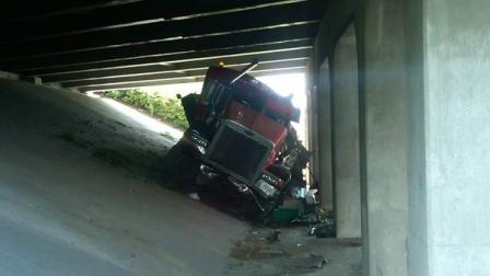 A tractor trailer crashed into a bridge along I-40 Tuesday afternoon after sideswiping a car.
