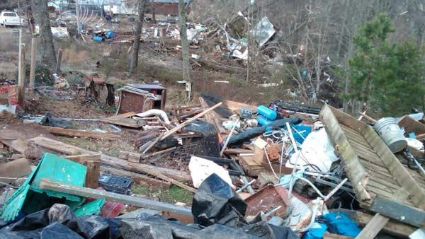 Debris from mobile home park in Icard after Wednesday night's storms