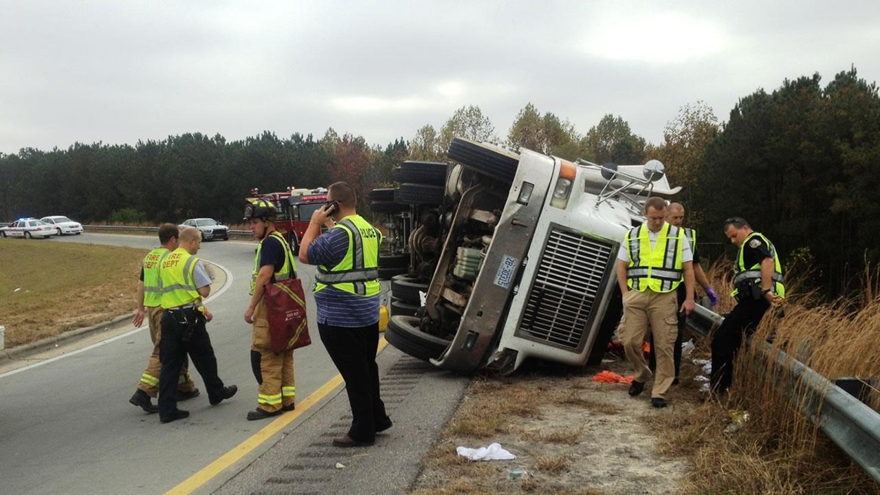 An 18-wheeler carrying mulch overturned on the ramp that connects I-540 south with US 64 East in Knightdale