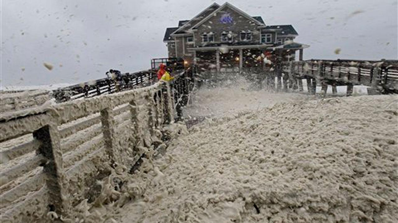 High winds blow sea foam onto Jeanettes Pier in Nags Head, N.C., Sunday, Oct. 28, 2012 as wind and rain from Hurricane Sandy move into the area.AP Photo/Gerry Broome