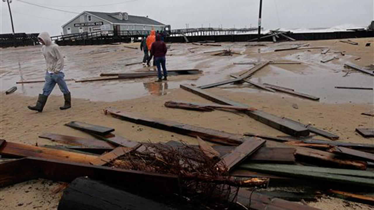 Debris from a sea wall and a damaged pier litters a parking lot at Avalon Pier in Kill Devil Hills, N.C., Monday, Oct. 29, 2012 after Hurricane Sandys wind and storm surge moved into the Outer Banks area.AP Photo/Gerry Broome