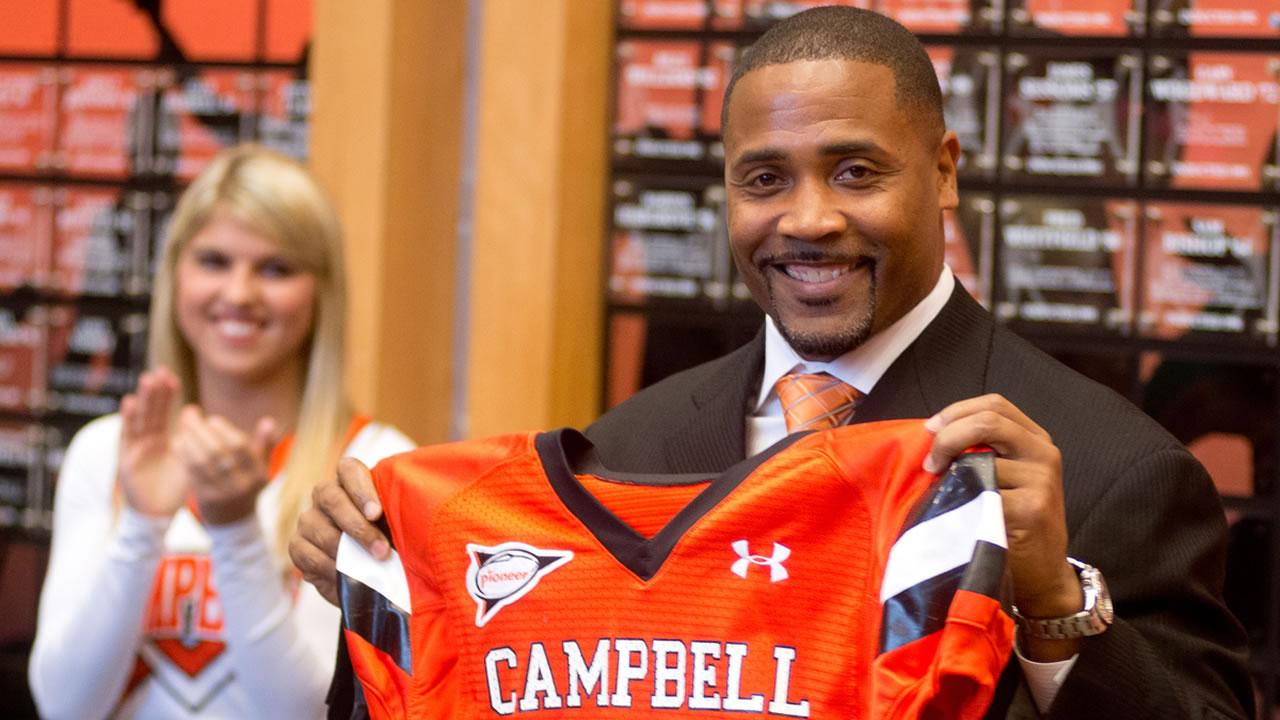 Campbell has hired former Carolina Panthers safety Mike Minter as its football coach.
