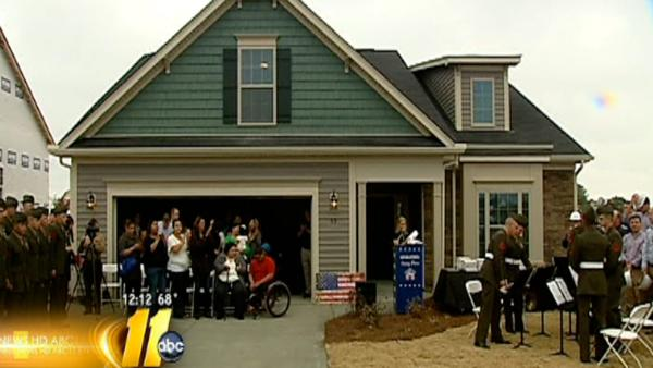Disabled veteran gets keys to new home