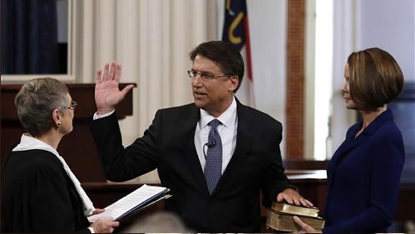 Gov.-elect Pat McCrory is sworn in as North Carolina's 74th governor by Chief Justice Sarah Parker as McCrory's wife Ann looks on at right in the House chamber of the old Capitol building in Raleigh, N.C., Saturday, Jan. 5, 2013.