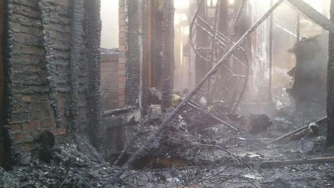 The family of five was able to escape the home unharmed, but the house is a total loss