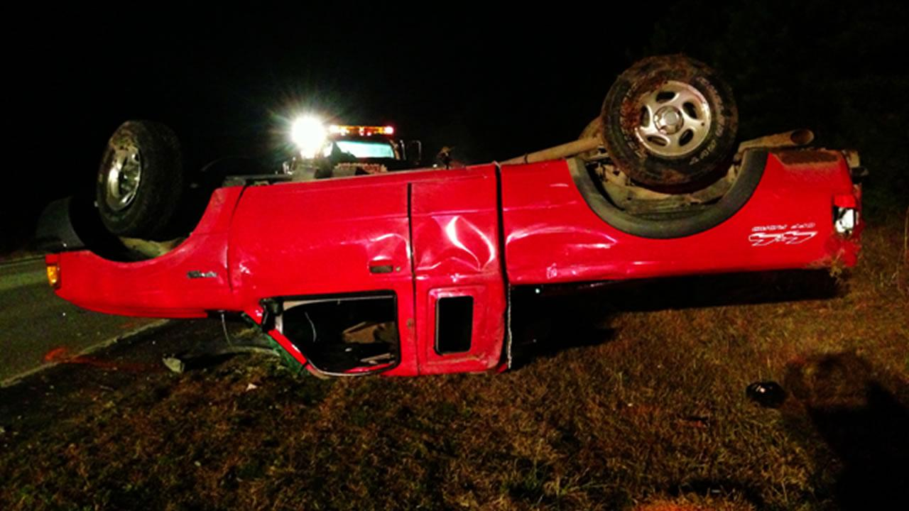 The red pickup truck rolled over in the shoulder of the road.Carter Rabil