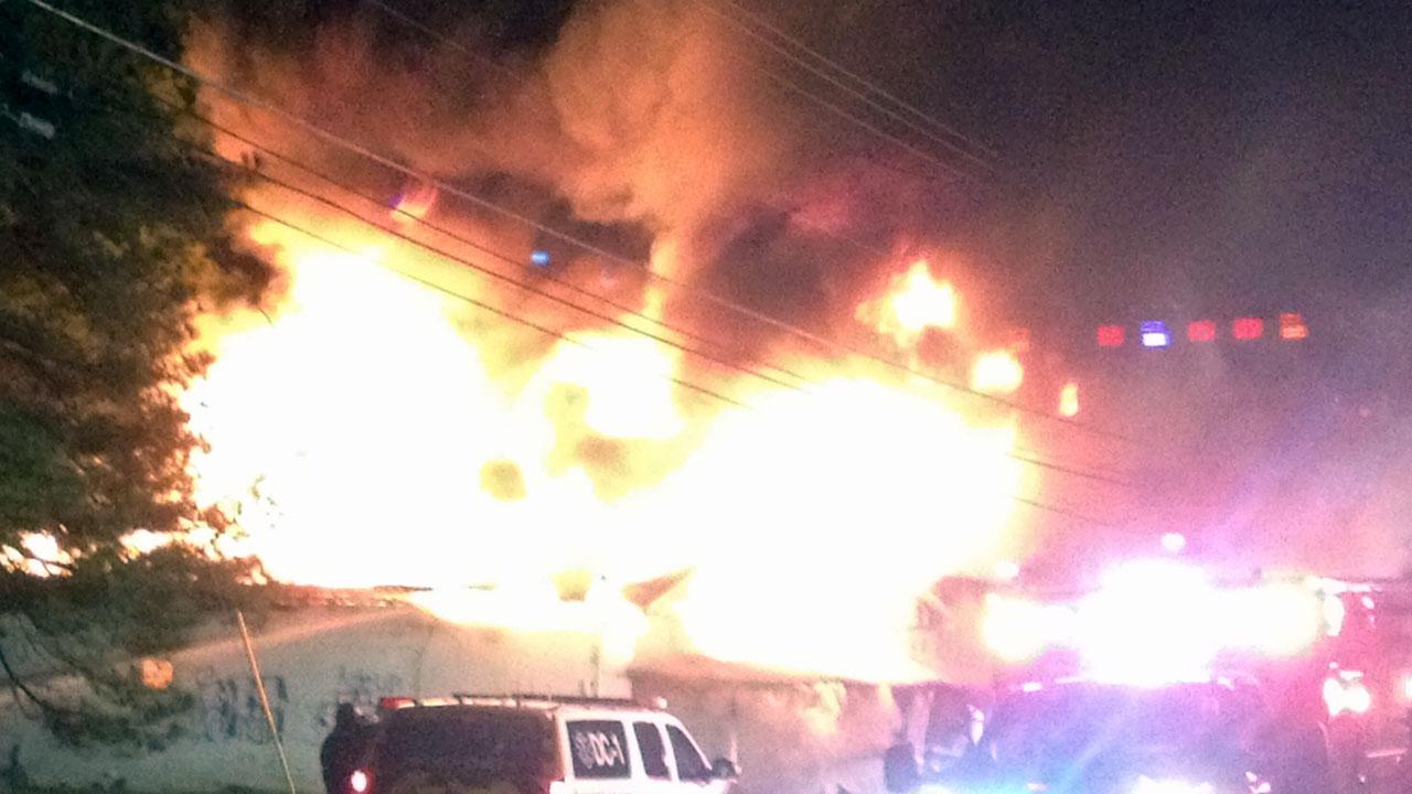 Firefighters battle fire at an abandoned building in the 4600 block of Old Poole Road in Raleigh just before 4:30 a.m. <span class=meta>(ABC11 Photojournalist Jeff Hinkle)</span>