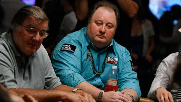 Professional poker player and 2004 champion Greg Raymer, center, play a hand during the first round on opening day of the World Series of Poker in Las Vegas on Monday, July 5, 2010.