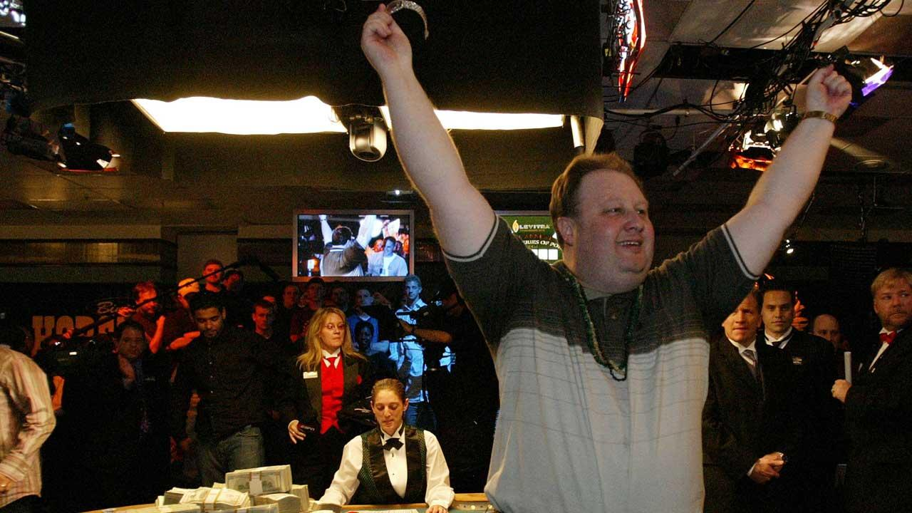 Greg  The Fossilman Raymer of Stonington, Conn., holds the championship bracelet after winning Friday, May 28, 2004 at the World Series of Poker at Binions Horseshoe in Las Vegas. Raymer takes home $ 5 million in cash, seen on the table at left. <span class=meta>(AP Photo&#47;Joe Cavaretta)</span>