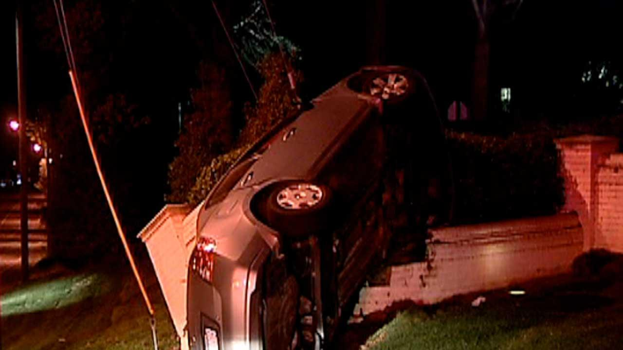 Two people were taken to the hospital early Friday morning after their car crashed into the entrance of Carolina Country Club in Raleigh.
