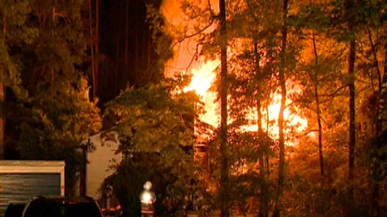 Family escapes from burning Durham home
