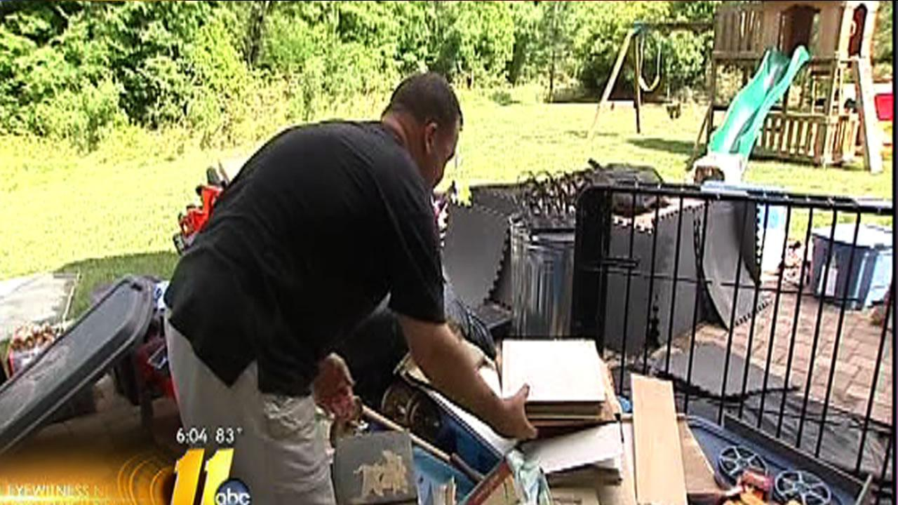 Residents clean up and count their losses the day after Tropical Storm Andrea flooded the area