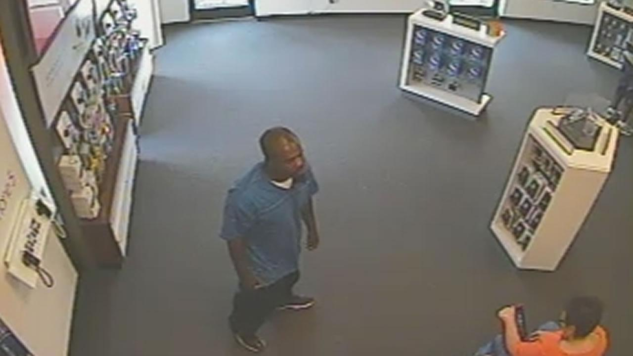 Police say the suspect acted as if he were a customer then made out with several iPhones. <span class=meta>(Image courtesy Fayetteville Police Department)</span>