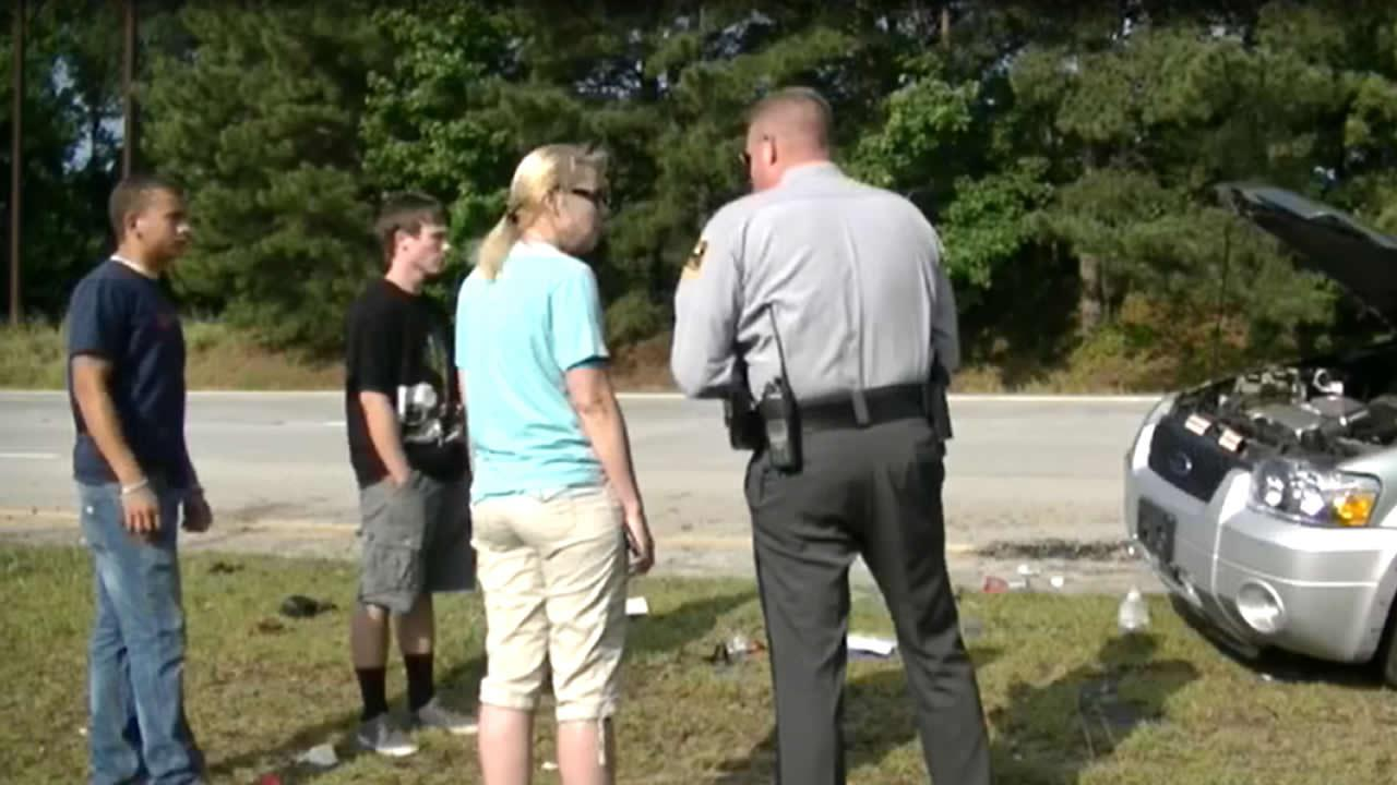 Troopers said charges are pending. The driver of the vehicle is seen wearing shorts and a black shirt in this photo. <span class=meta>(Jason Thompson)</span>