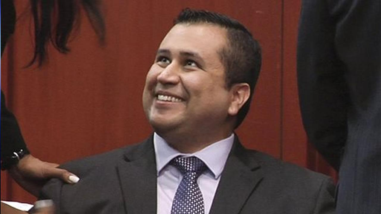 FILE - In this file image from video, George Zimmerman smiles after a not guilty verdict was handed down in his trial at the Seminole County Courthouse, Sunday, July 14, 2013, in Sanford, Fla.