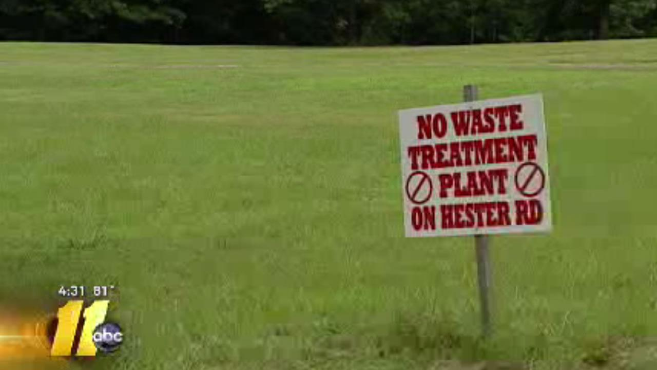 The signs are part of a campaign by Creedmoor residents to keep a water treatment plant out of their backyards.