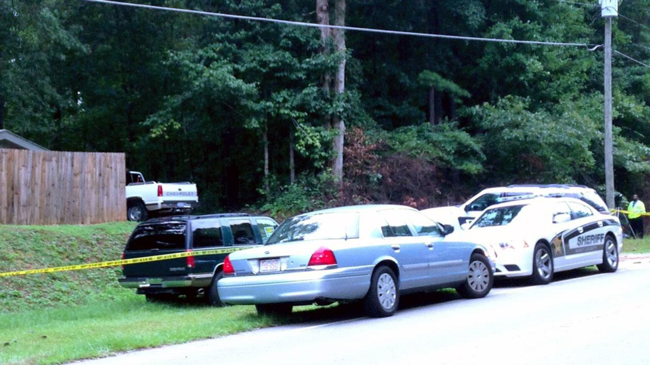 A Wake County man and a 13-year-old girl were shot overnight after answering a knock at their door.