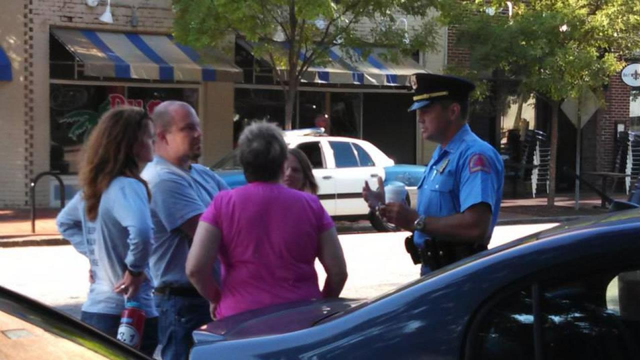 Raleigh police talking with volunteers with Love Wins Ministries