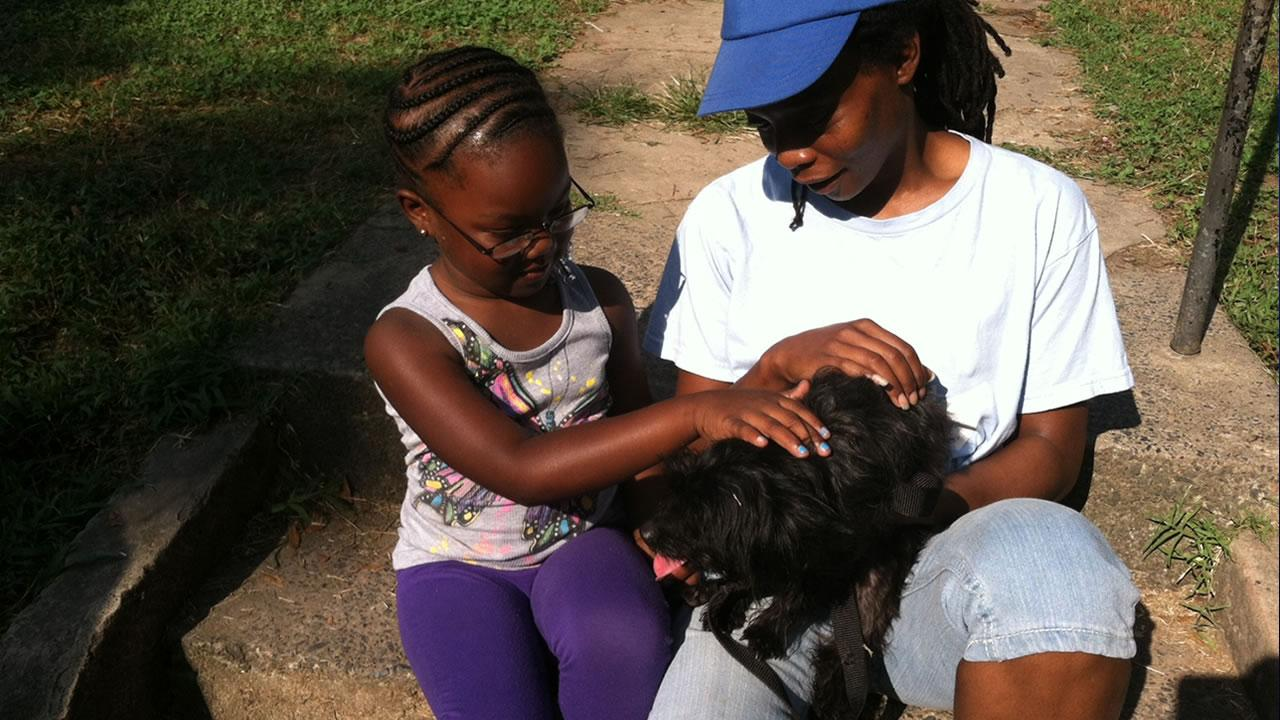On Saturday, 6-year-old Renaiya was surprised with her new pet, a 3-year-old Yorkie-Poo named Kisses.