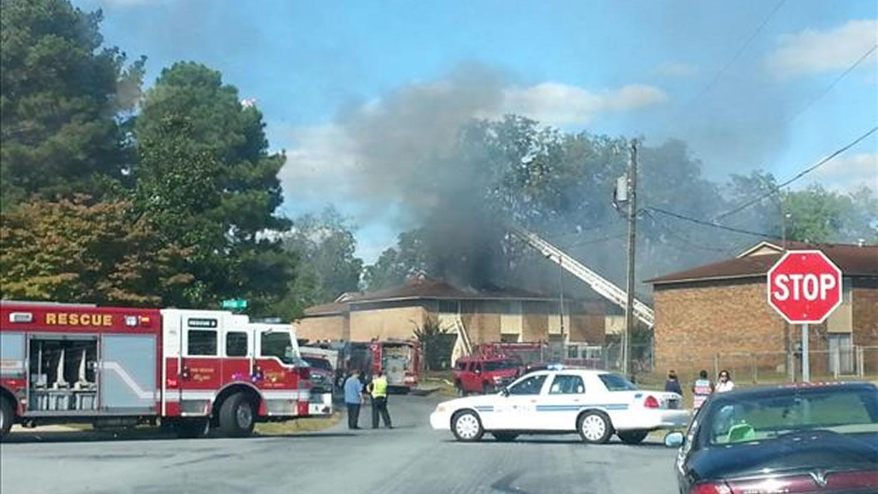 Firefighters on the scene of a fire at an apartment complexin Fayettevile on Wichita Drive