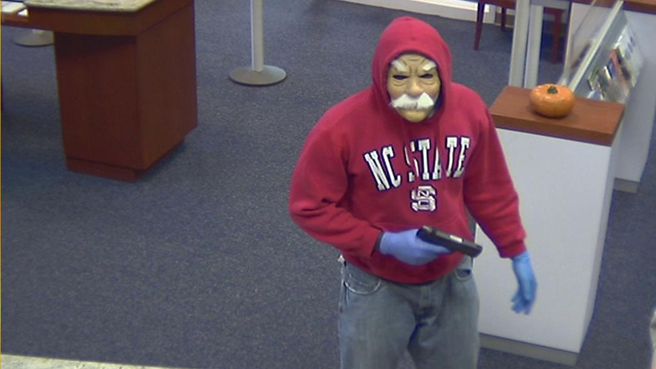 Two white males wearing Halloween masks robbed a bank on Governors Drive armed with handguns, according to officials.