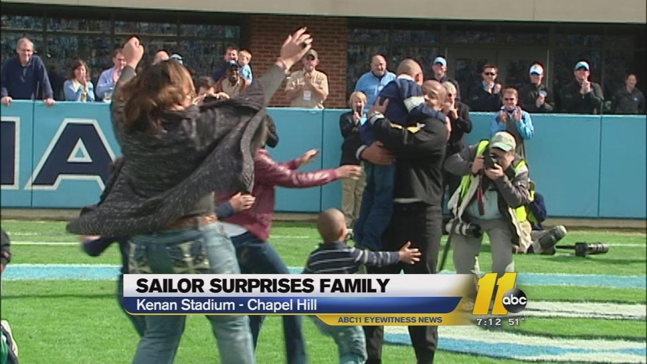 Dad makes surprise military homecoming at UNC game