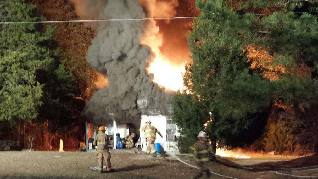 Flames were seen shooting from the roof of a house on NC-39 outside of Bunn Thursday morning. <span class=meta>(Photo courtesy of an ABC11 viewer)</span>