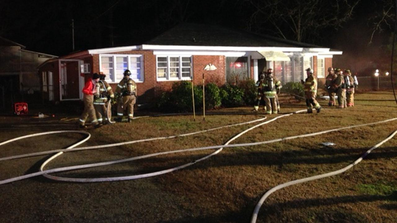 An elderly woman was hospitalized overnight after her Johnston County home caught on fire.